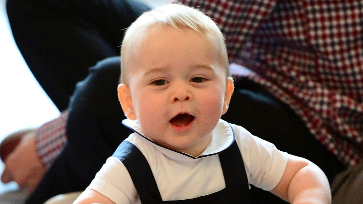 Image: Britain's Prince George plays with a toy at a Plunket play group event at Government House in Wellington