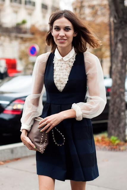 Layering a ruffled blouse under a dress or a pair of overalls is a great way to modernize the look while also adding a bit of flair to a regularly basic item.