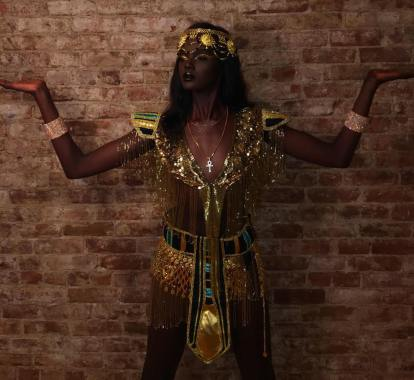 Duckie Thot as Cleopatra